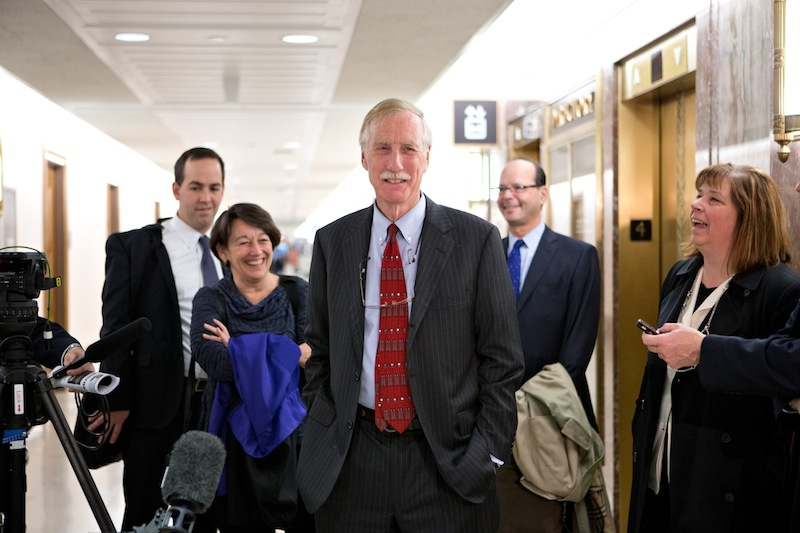 Sen.-elect Angus King, I-Maine, center, the former governor of Maine, arrives on Capitol Hill in Washington, Tuesday, Nov. 13,2012, to meet with Republican Sen. Susan Collins, R-Maine to discuss committee assignments and how they'll work together to represent Maine in the Senate. (AP Photo/J. Scott Applewhite)