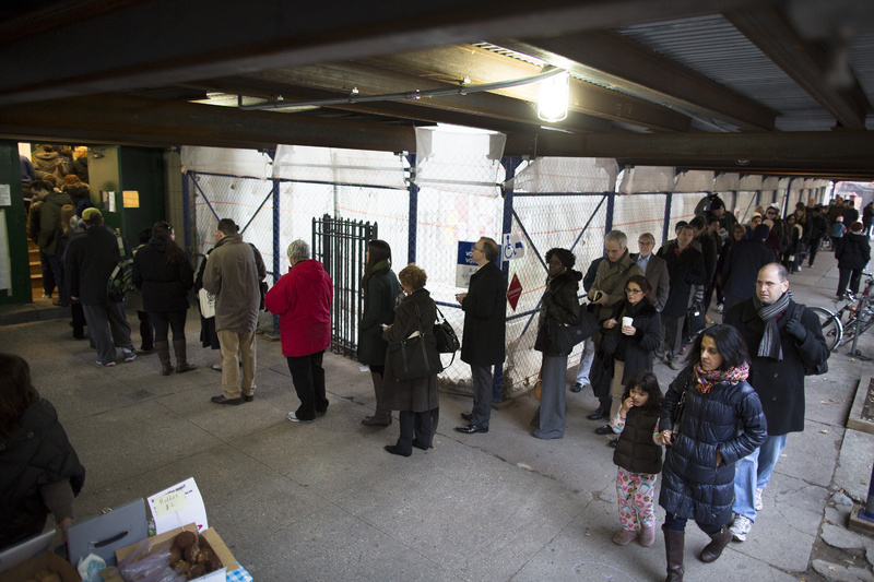 Voters wait for their chance to cast a ballot at P.S. 29 in the Cobble Hill neighborhood of Brooklyn Tuesday. Some voters in New York and New Jersey expressed elation at being able to vote at all after the disruption of superstorm Sandy.