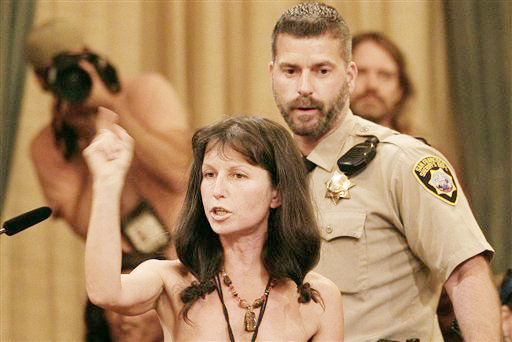Protester Gypsy Taub speaks out against the Board of Supervisors decision to ban public nakedness at City Hall in San Francisco on Tuesday. The nudist activist who organized naked protests and marches in the weeks leading up to Tuesday's meeting, disrobed in protest before sheriff's deputies escorted her from the room.