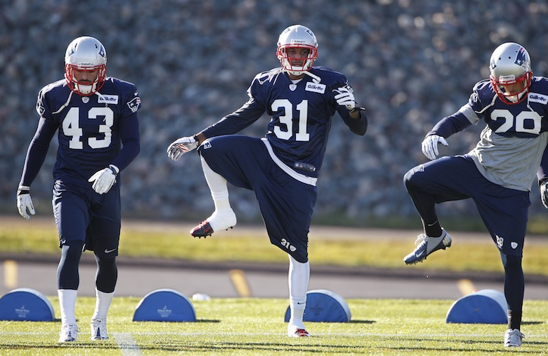 Newly acquired New England Patriots cornerback Aqib Talib (31) stretches with defensive back Nate Ebner (43) and safety Steve Gregory (28) during practice at the NFL team's facility in Foxborough, Mass., Wednesday, Nov. 14, 2012. (AP Photo/Stephan Savoia) Gillette Stadium