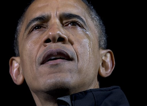 Tears run down the cheek of President Barack Obama as he speaks at his final campaign stop on the evening before the 2012 election, in the downtown Des Moines, Iowa.