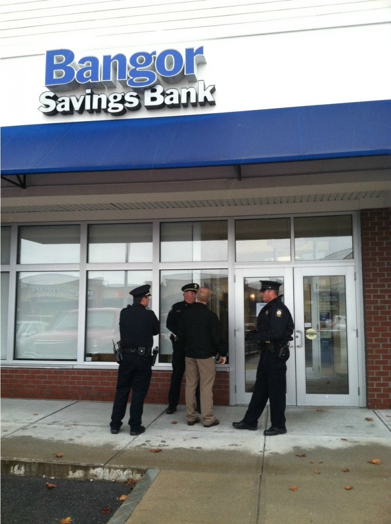 Portland Police arrived on the scene Tuesday morning after someone robbed the Bangor Savings Bank branch at Pine Tree Shopping Center on Brighton Avenue.