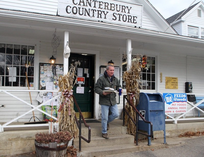 Kevin Brags leaves the Canterbury Country Store after buying his coffee and Powerball ticket, Wednesday, Nov. 28, 2012 in Canterbury, N.H. (AP Photo/Jim Cole)