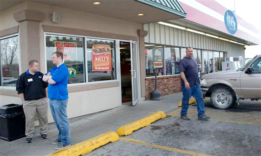 An unidentified customer walks out of the Trex Mart convenience store in Dearborn, Mo., where Mark and Cindy Hill purchased one of the two winning Powerball tickets.