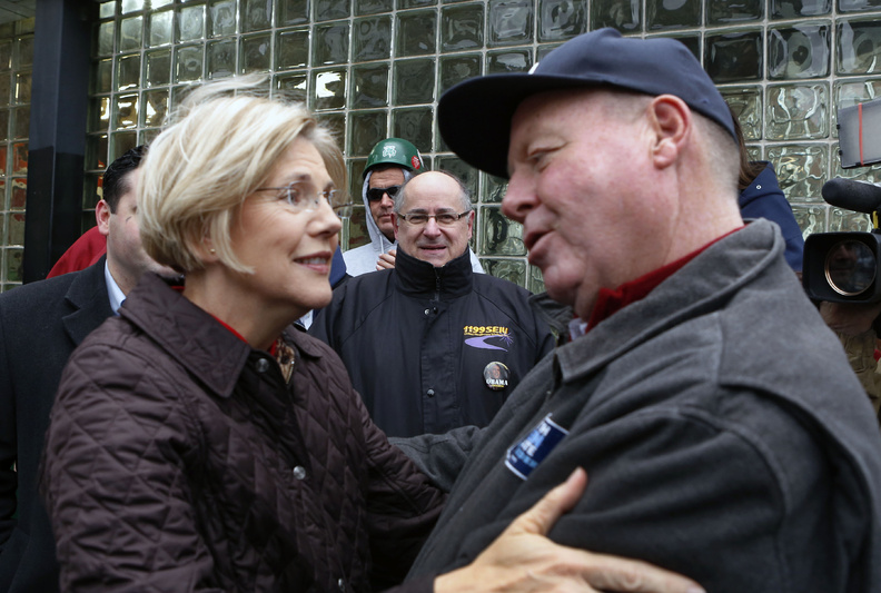 Sen.-elect Elizabeth Warren is congratulated by Mark Walsh of Boston as she thanks Massachusetts residents on Wednesday in Boston. Warren defeated incumbent Republican Sen. Scott Brown.