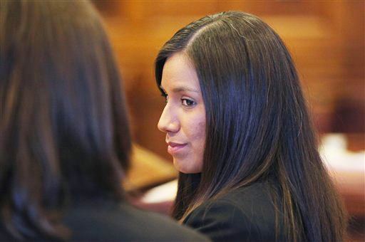 An Oct. 9, 2012, photo of Alexis Wright, 29, during her arraignment in Portland on 109 counts of prostitution, violation of privacy, tax evasion and other charges for allegedly providing sex for money at her Kennebunk fitness studio and office.