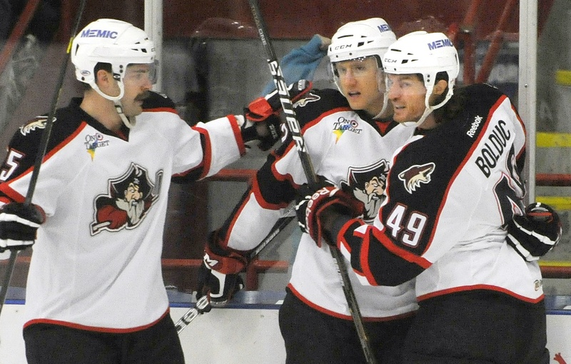 Chris Summers, left, and Alexandre Bolduc congratulate Rob Klinkhammer, center, on a goal in a Pirates game. They may soon be congratulating each other on food they've cooked.