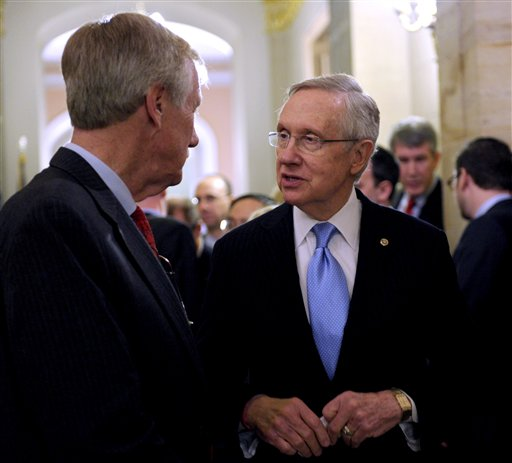 Senate Majority Leader Harry Reid of Nev., left, talks with Sen.-elect Angus King, I-Maine on Capitol Hill in Washington, Wednesday, Nov. 14, 2012. King said Wednesday he has decided to caucus with Democrats, which will add to the party's voting edge. (AP Photo/Susan Walsh)