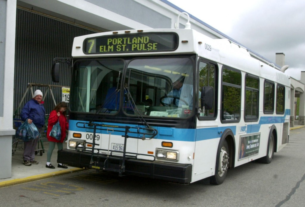 In this 2004 file photo, passengers board the Falmouth Flyer Metro Pulse bus at Wal-Mart in Falmouth. Voters on Tuesday, Nov. 6, 2012 rejected a measure to end bus service.