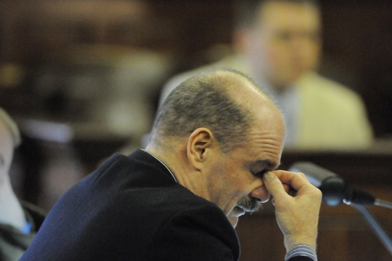Randall Hofland of Searsport listens as Justice Jeffrey Hjelm reads the dozens charges against him in January 2011.