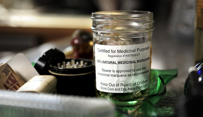 "A jar of marijuana labeled ""Certified for Medical Purposes."""