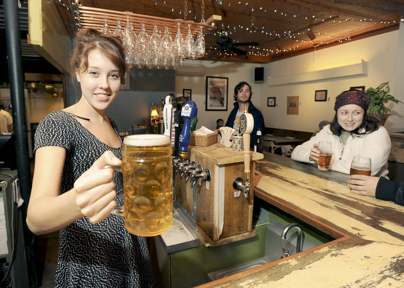 Reegan Brown pours a draft at Bonobo in Portland's West End.