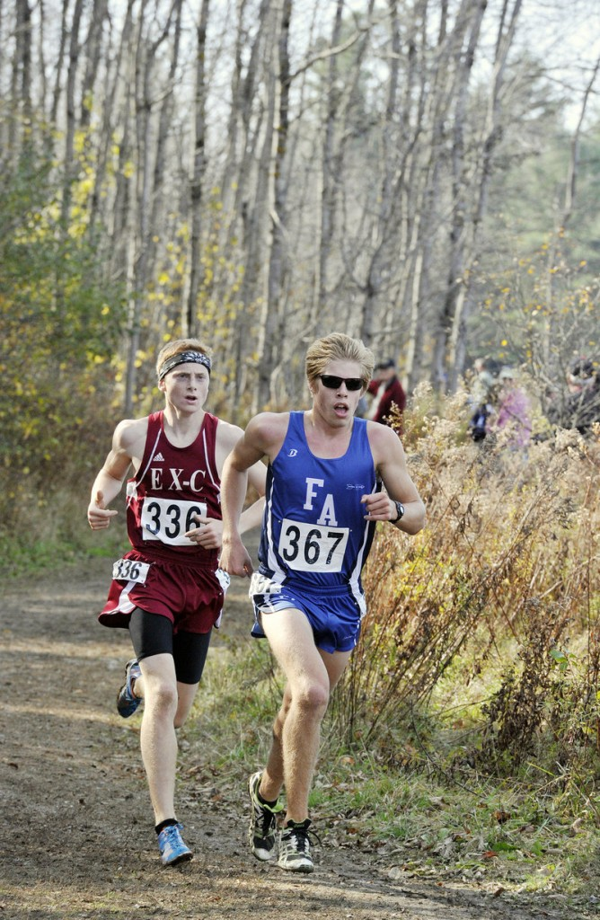 Ellsworth's Dan Curts keeps pace with Fryeburg Academy's Silas Eastman at the state championships in Belfast on Oct. 27.