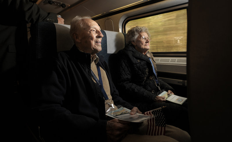 Nelson Soule, 92, of Cumberland, rides the Amtrak Downeaster with his wife, Margaret, as it makes its inaugural run north of Portland to Freeport and Brunswick on Thursday.