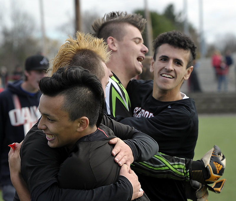 Patrick Stanton, center, posted his 10th shutout of the season Saturday as Scarborough beat Mt. Ararat 4-0 in the Class A championship game at Hampden.