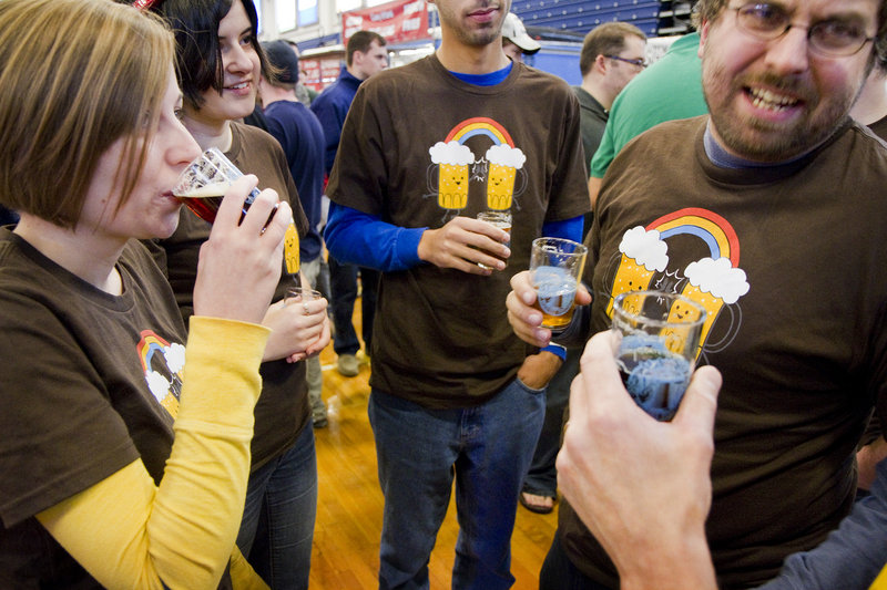 Wesley Littlefield of Pittston, right, shares a thought while sampling local brews with Alyssa Littlefield of West Gardiner, left, and Kaitlynn Littlefield of Pittston.