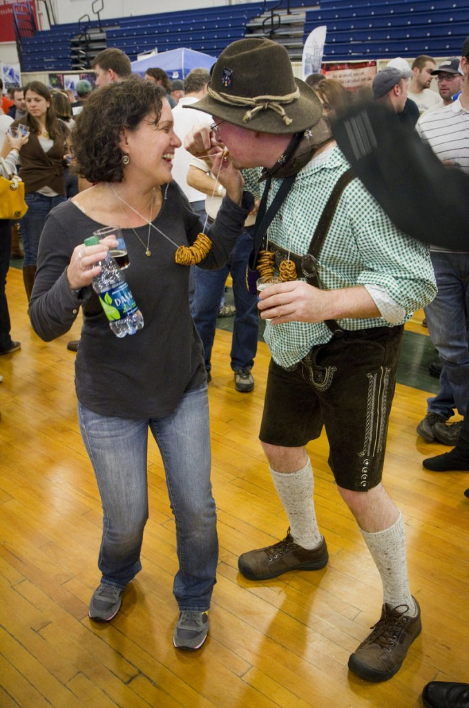 Julie Nadeau of Brighton, Mass., shares her pretzel necklace with Paschal Healy, who flew from Ireland to attend the Maine Brewers Festival at the Portland Expo on Saturday.