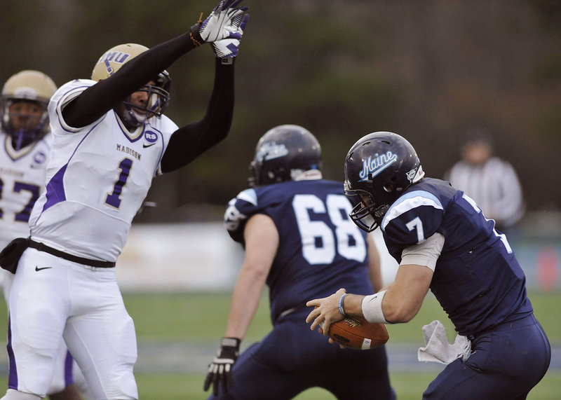 Maine quarterback Marcus Wasilewski (7) is unable to avoid James Madison safety Titus Till (1) who got the sack in the first half of Saturday's game.