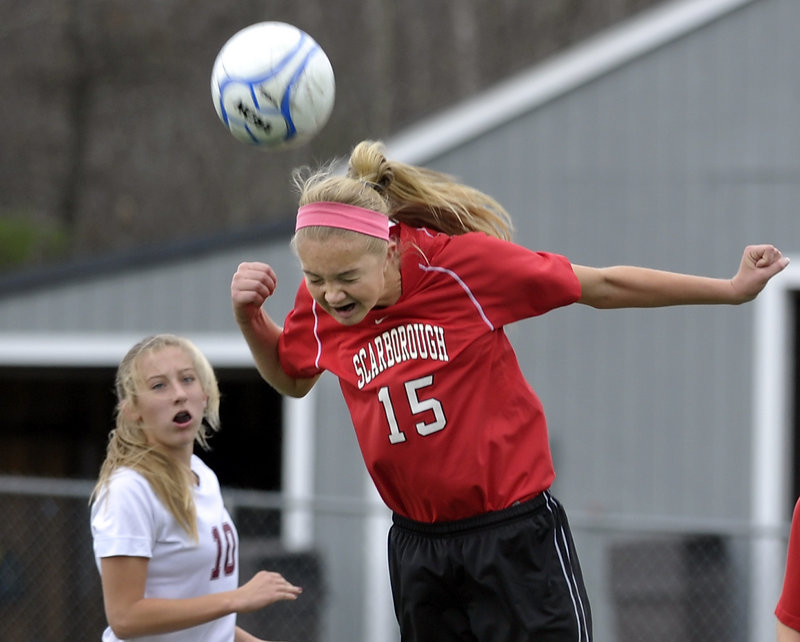 Ainsley Jamieson of Scarborough plays a header during the Class A girls' soccer championship game against Bangor. Scarborough won 2-1 in overtime, avenging a loss to the Rams in last year's state final.