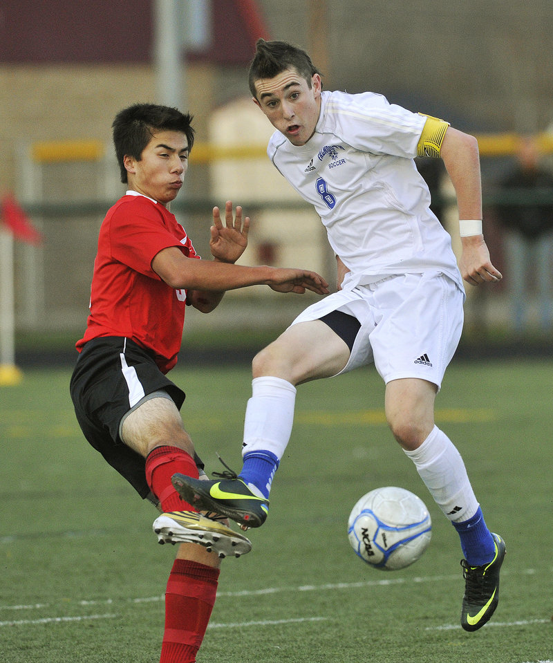 Cooper Lycan, right, of Falmouth plays the ball in front of Camden Hills' Tristan Fong during the Class B boys' soccer final Saturday. Falmouth fell behind early in the second half but quickly regrouped, defeating the Windjammers for the second year in a row, 2-1.
