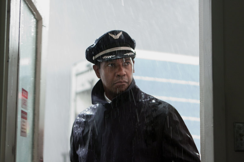 "Denzel Washington portrays Whip Whitaker in a scene from ""Flight."" Washington plays an airline pilot who, despite being hungover, drunk and coked-up, lands a rapidly deteriorating plane."