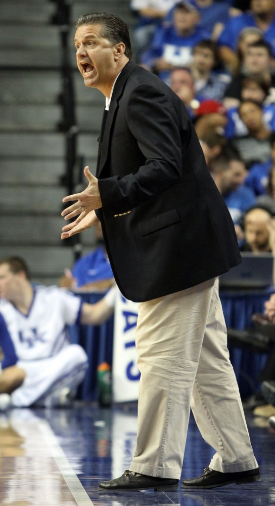 John Calipari gives some instruction to his Kentucky men's basketball team during a preseason scrimmage.