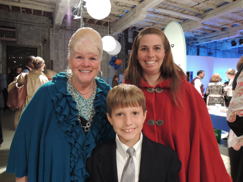 Eight-year-old Matthew Gilbert (foreground), who won the John Ford Regatta for new sailors in August, with his grandmother Jan Robinson of Boston and mother Lisa Gilbert of Cumberland. Matthew followed in the footsteps of his older brother, Joseph Gilbert, who was the winner in 2011.