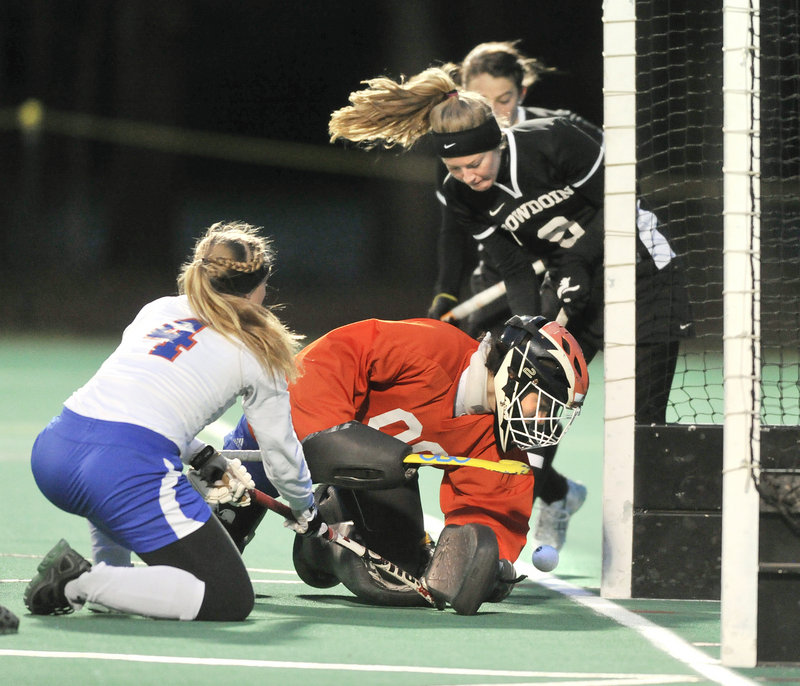 Cathleen Smith (9) slips the ball behind SUNY-New Paltz goalkeeper Antonija Pjetri to put Bowdoin up 4-0 en route to Wednesday's 6-1 victory in the first round of the NCAA Division III field hockey tournament in Brunswick.
