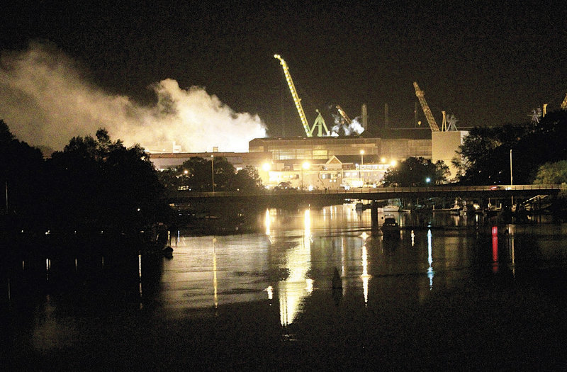 Smoke rises from a dry dock on May 23 as fire crews respond to a blaze on the USS Miami SSN 755 submarine at the Portsmouth Naval Shipyard in Kittery.