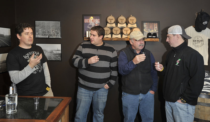 Ned Wight, left, founder and owner of New England Distilling, tells of the family legacy that gave him the idea to resurrect a distillery and produce fresh, creative and different types of gin, rum and whiskey, as three members of the Pour Tour, from left, Jeremy Miller, David Lamarre and Adam Lamarre, taste and discuss the Ingenium Dry Gin.