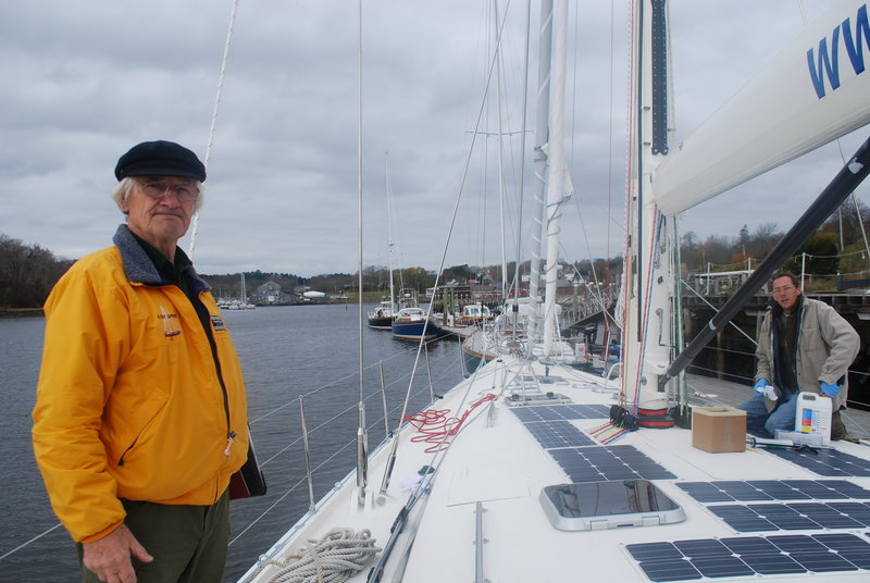 "Stanley Paris, 76, standing on the deck of ""Kiwi Spirit,"" which was launched in Thomaston, has a year to prepare for the around-the-world, solo unassisted voyage that he hopes to complete in 120 days. The record for such a trip is 150 days, set by Dodge Morgan in 1986."