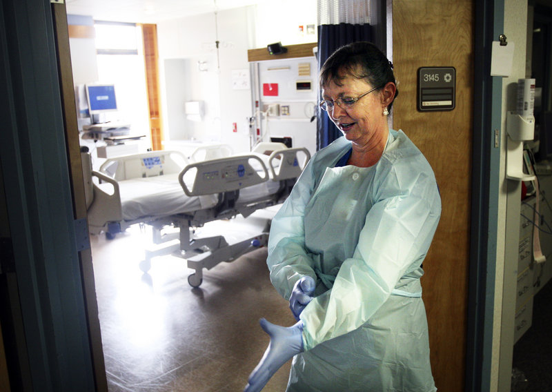 A nurse in Salem, Ore., dons a protective gown, gloves and mask as she enters the room of a patient with a MRSA infection. Overreliance on antibiotics encourages drug-resistant bacteria like MRSA, a state health official says.
