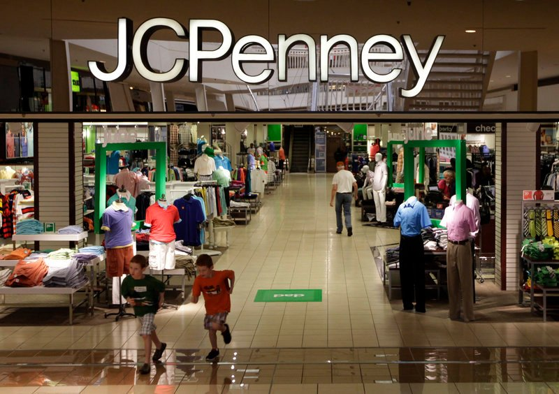 In this Tuesday, June 19, 2012 file photo, shoppers walk in a J.C. Penney story in Plano, Texas. J.C. Penney Co. reported a bigger-than-expected loss in the third quarter on plummeting sales as customers continue to reject its move get rid of blockbuster sales in favor of everyday low pricing, according to reports Friday, Nov. 9, 2012. (AP Photo/LM Otero)