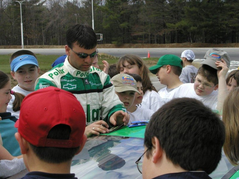 "Jason Fowler signs autographs for young fans in this photo taken about 10 years ago. Fowler ""always would put a smile on someone's face,"" a friend wrote on his Facebook page."