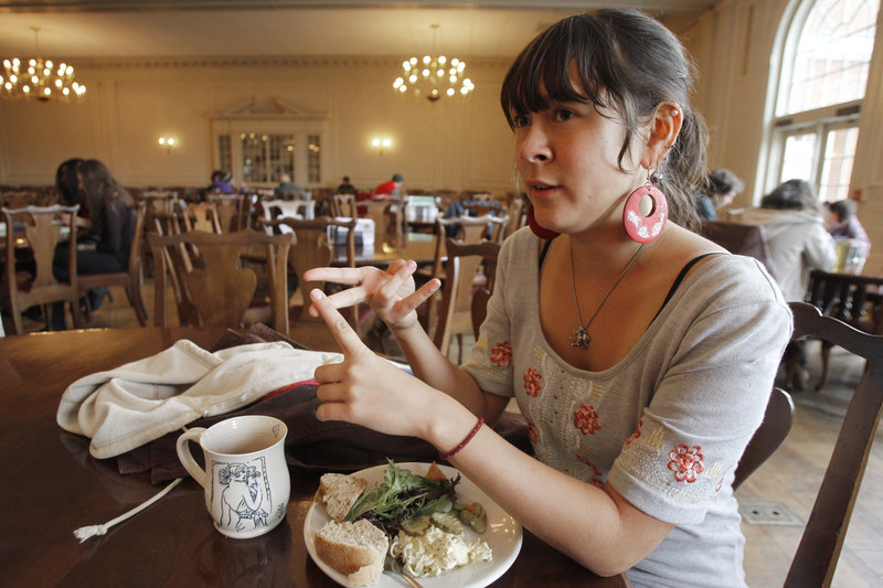 Meiko Lunetta, a vegetarian, talks to a reporter in the dining hall at Green Mountain College. She supports the college's decision.