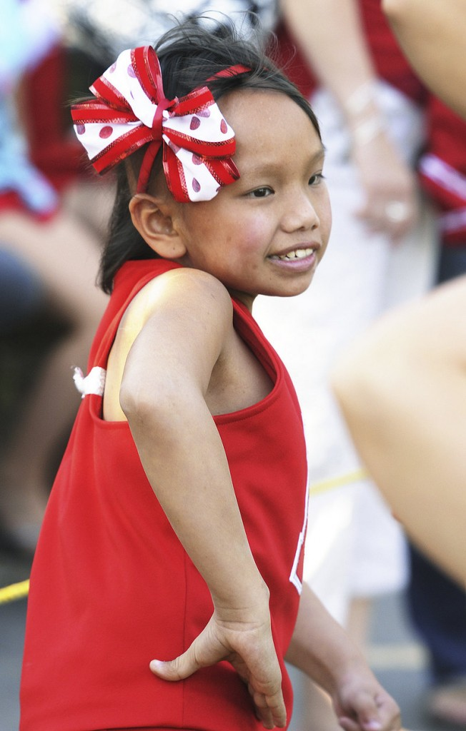 Zoe McMorran cheers on the sidelines of a North Attleboro Junior Football game last month.