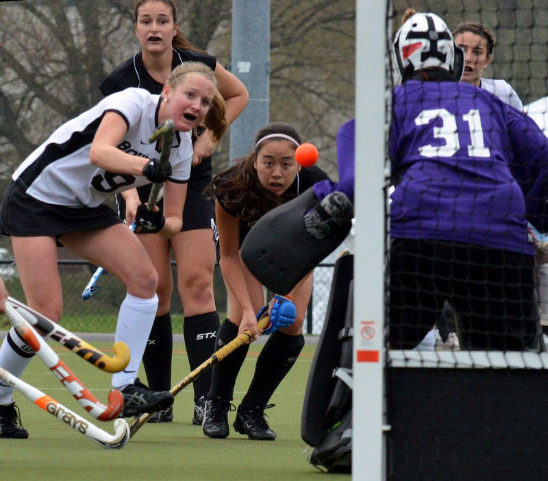Cathleen Smith of Bowdoin sends a shot toward MIT goalie during the first half of Saturday's NCAA tournament game in Geneva, N.Y. Smith later scored one of Bowdoin's three first-half goals in a 3-1 win.