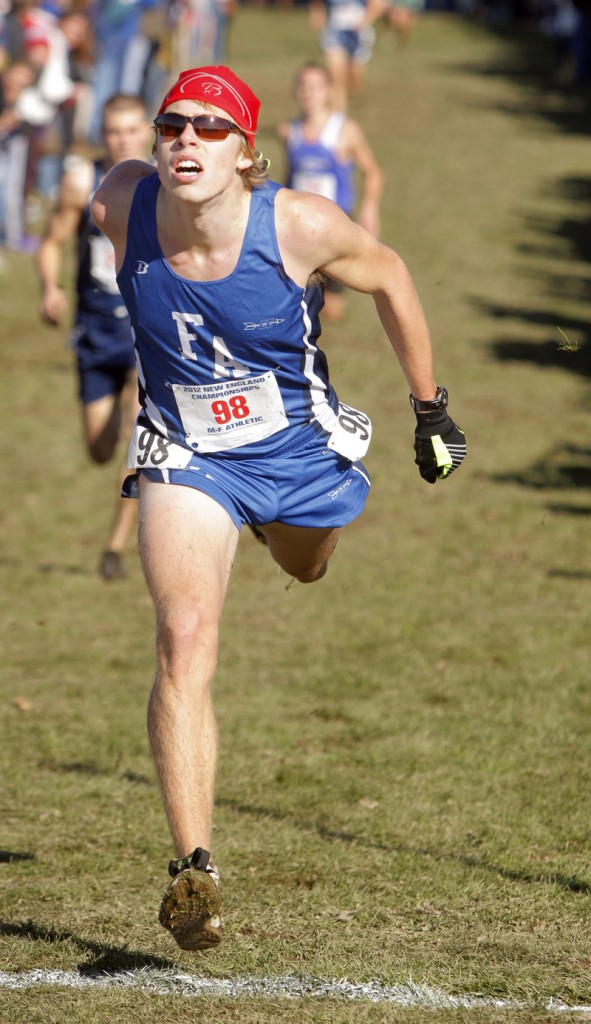 Fryeburg's Silas Eastman lunges for the finish line to take third place at the New England high school cross country championships.