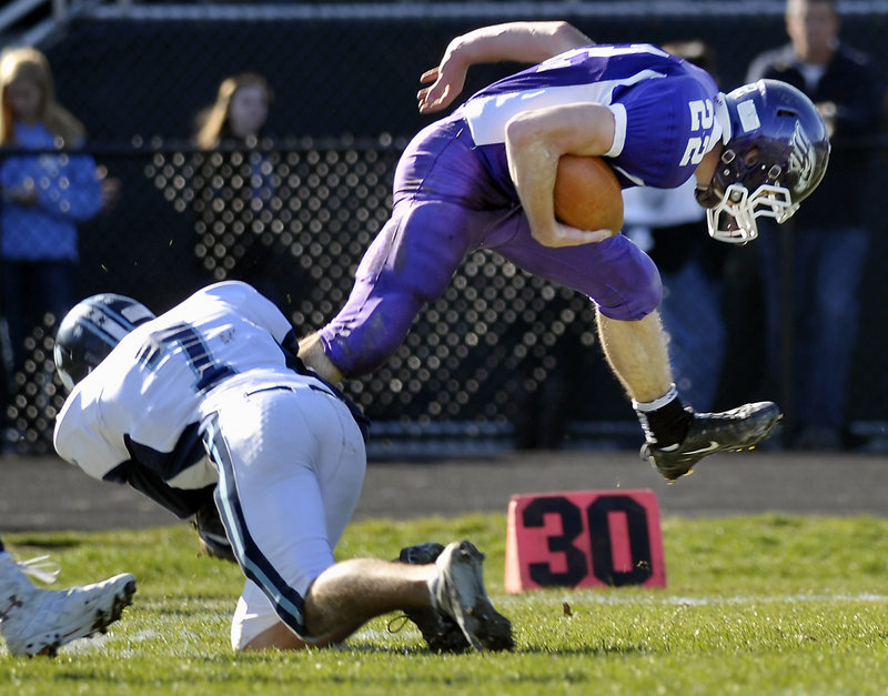 Marshwood quarterback Cameron Roll, who rushed for 105 yards, is brought down by Jordan Pidgeon of York.