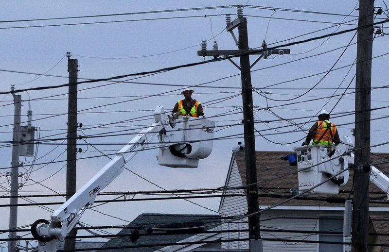 Utility crews work on power lines Nov. 1 in response to Superstorm Sandy as dusk falls in Ship Bottom, a community on Long Beach Island, N.J. New York Gov. Andrew Cuomo has called for investigation of the region's utilities, criticizing them as unprepared and badly managed.