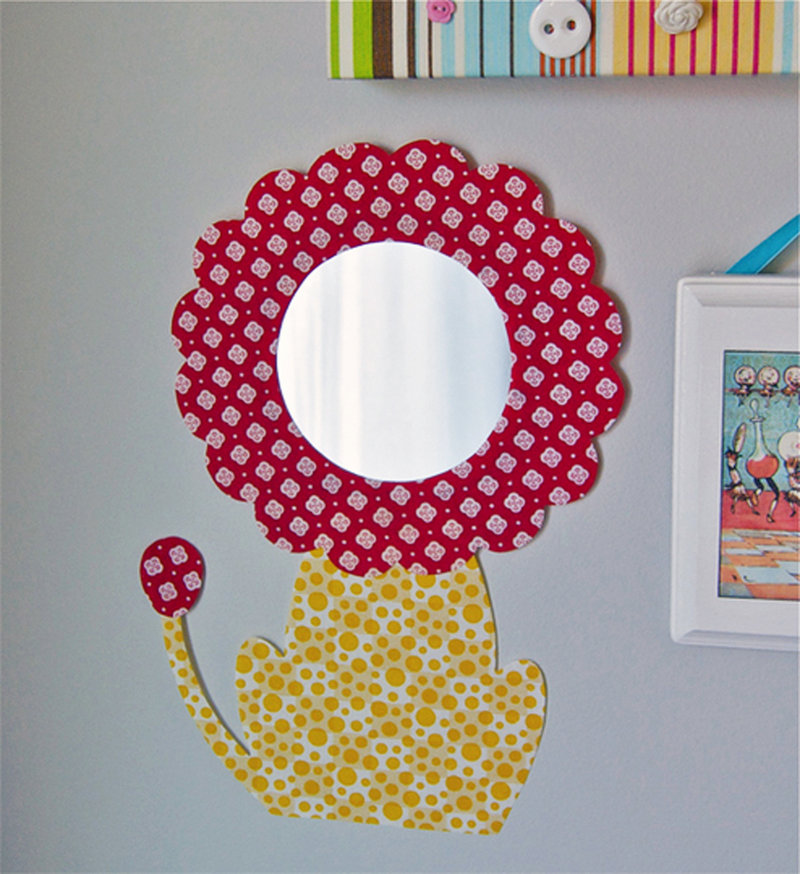 I am baby, hear me roar: Fabric frames a nursery mirror, creating a darling lion motif.