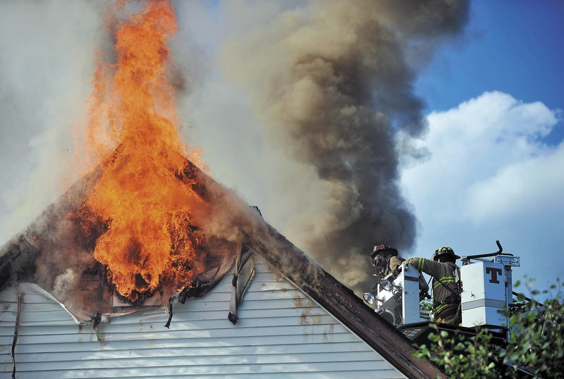 Waterville firefighters battle a blaze that left Jeff and Janet White homeless in August.