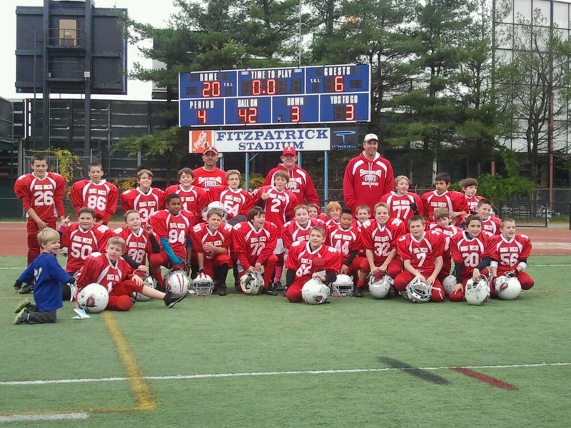Members of the South Portland Big Red team that won the Maine Youth Football League State Championship, from left to right: Front row – Bradley McMains, Thomas Chaney, Anthony Poole, Eric Walker, Ryan Boles and Kevin Connor; Second row – Michael Delev, Simon Rascher, Geremi Baez, Sam Rumelhart, Nicholas Borelli, Shamus Cole, Boden Abbott, Walter Clay, Jaden Bao, Dylan Adams, Connor Dobson and Cade Carr; Third row – Corey Gagne, Alex Stevens, Ryan Curran, Andrew Riley, Owen Bean, Noah Dreifus, Tyler Brown, Anthony Napolitano and Kyle Rand. Back row – Coaches Tony Napolitano, Jim McDonald and Joel Rumelhart.