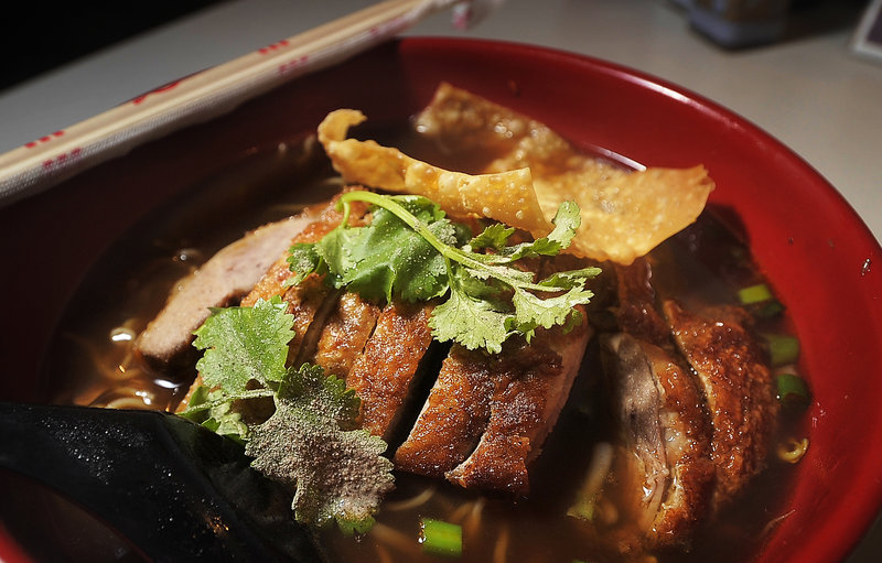 A bowl of noodles with crispy duck and five-spice broth at Pom's Thai Taste in Portland.