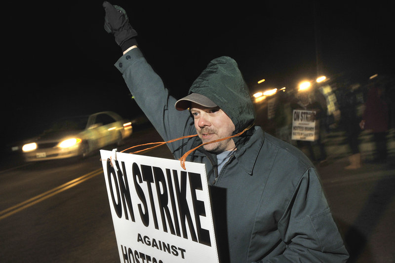 Hostess Brand workers in Biddeford ignored a Thursday deadline to return to work. Dale Dewitt, of Gorham, mans the picket line along with his fellow workers.