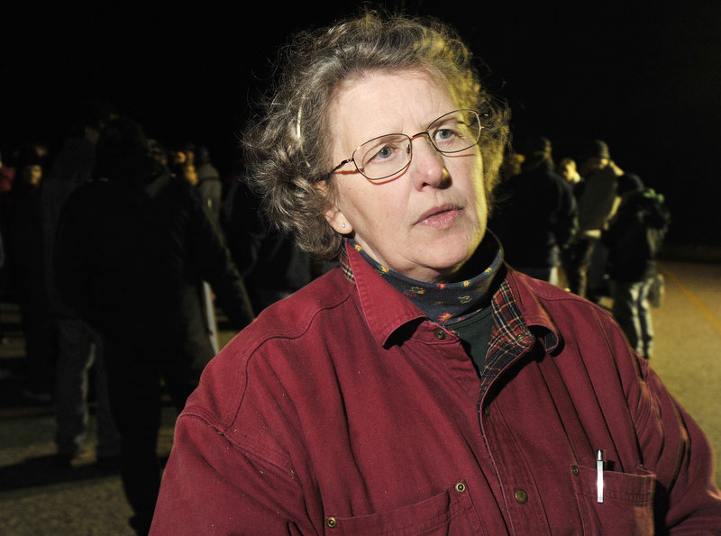 Sue Tapley, a 13-year employee, was one of many workers picketing the company.