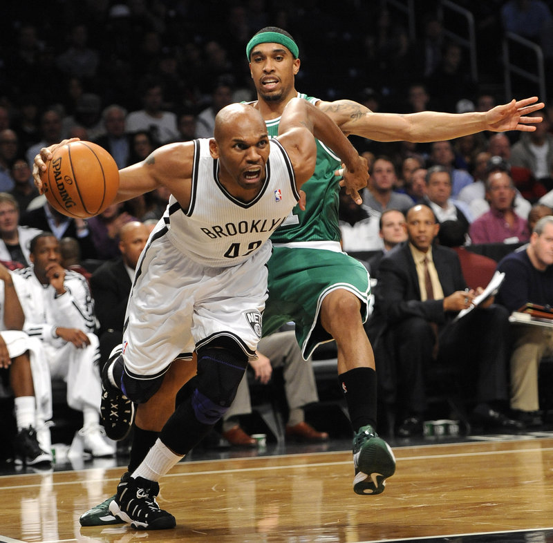 Jerry Stackhouse of the Brooklyn Nets drives past Courtney Lee of the Celtics in the first half Thursday night.