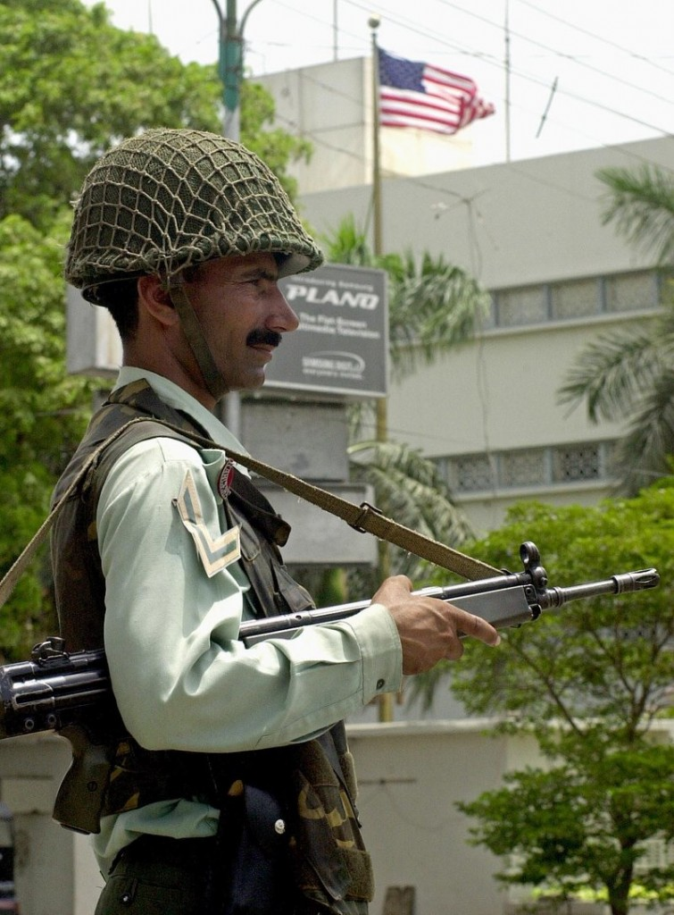 A paramilitary soldier guards the U.S. Consulate in Karachi, Pakistan, in 2002, after an attack in which 10 people died. There were several lethal attacks on U.S. diplomatic stations when George W. Bush was president, but Democrats didn't call for a