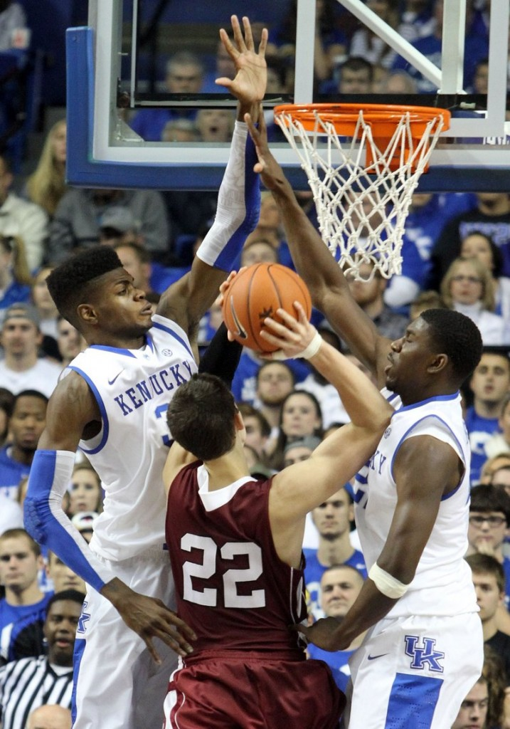 Lafayette's Alan Flannigan (22) tries to find room for a shot against Kentucky's Nerlens Noel, left, and Alex Poythress during Kentucky's 101-49 win at home Friday.