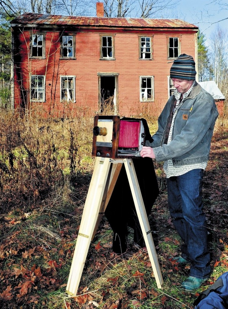 Scott Anton prepares his view camera that uses glass plate negatives to photograph the John Wentworth home in Athens that was built in 1800.